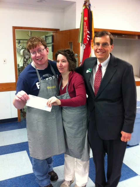 Matt and Maggie receive a generous donation from Paul Geraghty, WSFS Bank Vice President.